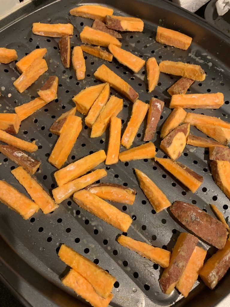 sweet potato fries on a baking tray before being cooked
